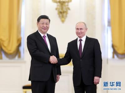习近平同俄罗斯总统普京举行会谈 两国元首共同宣布发展中俄新时代全面战略协作伙伴关系